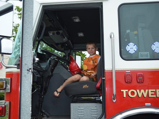 Andrey Bauman, 5, of Vineland sits in a Vineland Fire