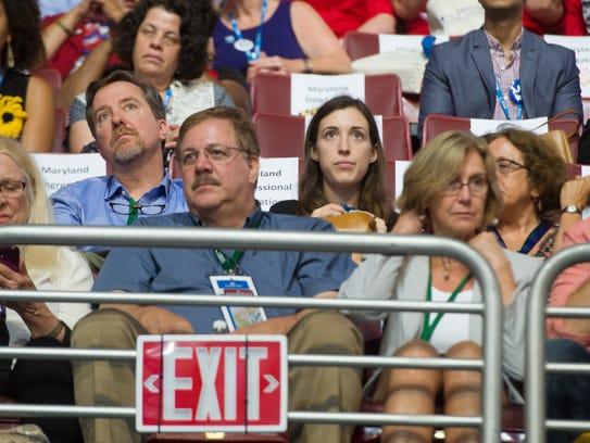 Vermont Secretary of State Jim Condos, center, listens