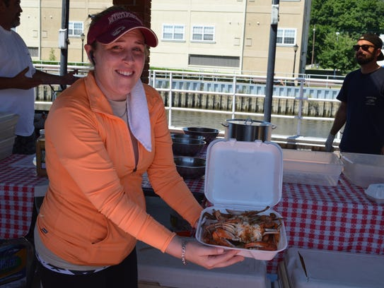 Kelly Forsstrom, co-owner of Marty's Crabs, displays