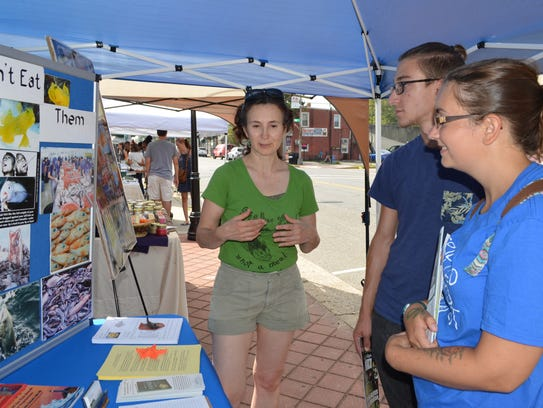 Mary Finelli of Fish Feel talks with visitors Joanna