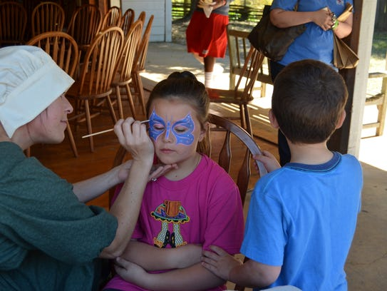 Face painting is among the activities at Boo Bayou,