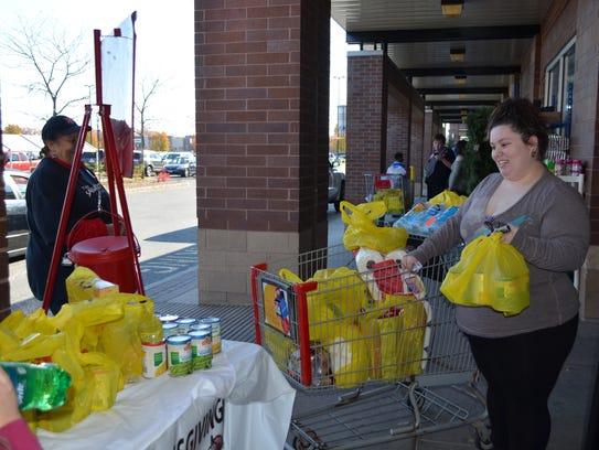 Randy Hitchner of Hopewell donates nonperishable items