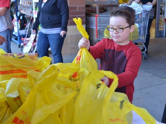 Ryan Morgan, 8, of Cedarville donates food to Project