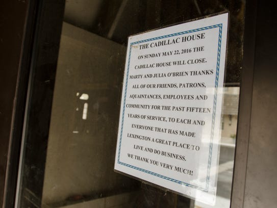 A sign announces the closure of the Cadillac House