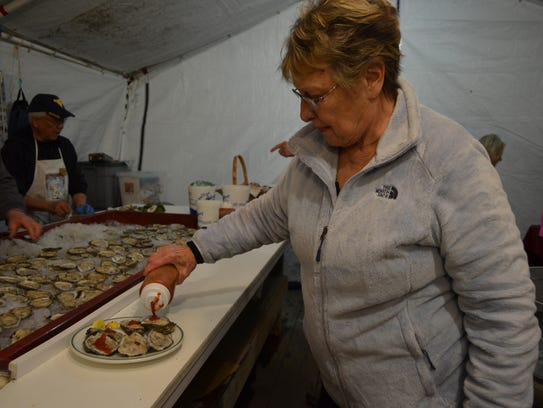Joyce Bianco of Somers Point dresses a plate of oysters