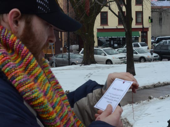 Eric Charbonneau reads the card that came with his