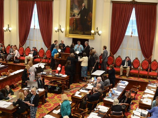 Members of the House of Representatives gather at the