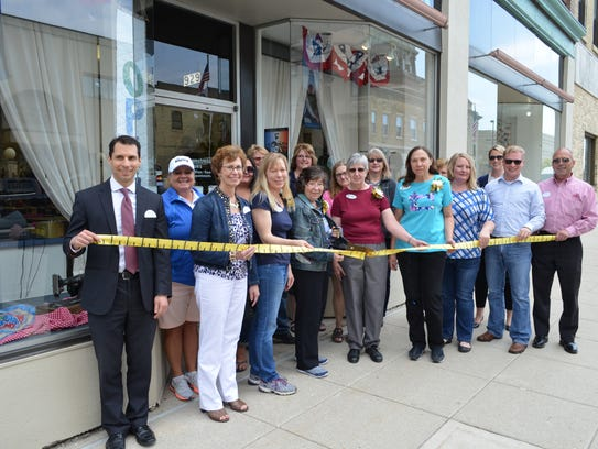 The Seamstress recently held a 20th anniversary ribbon-cutting