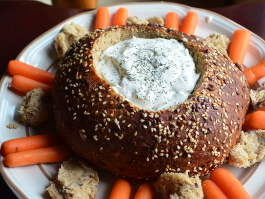 Dilly Dip is a homemade dill dip served in a pumpernickel