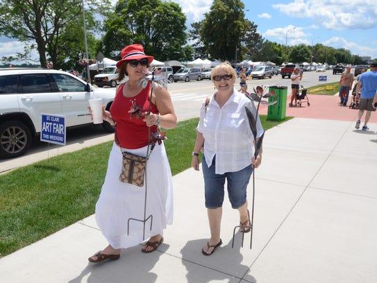 Toni Herman, left, and Bonnie Mumford, both of St.
