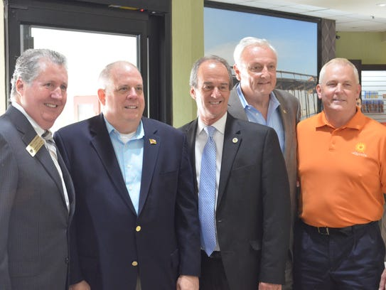 Md. Gov. Larry Hogan (second from left), poses with