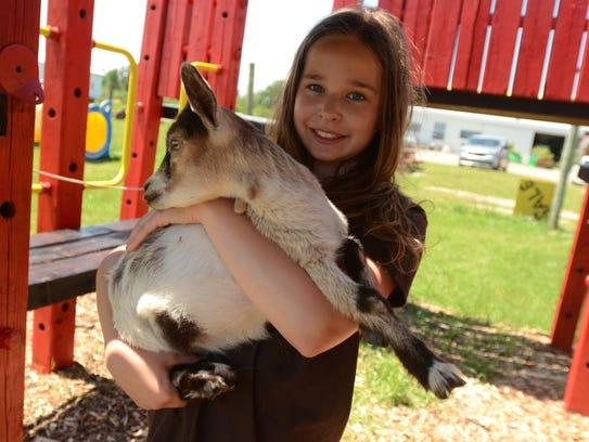 Brooke Peltier holds Sweetie Pie, a 7-week-old goat.