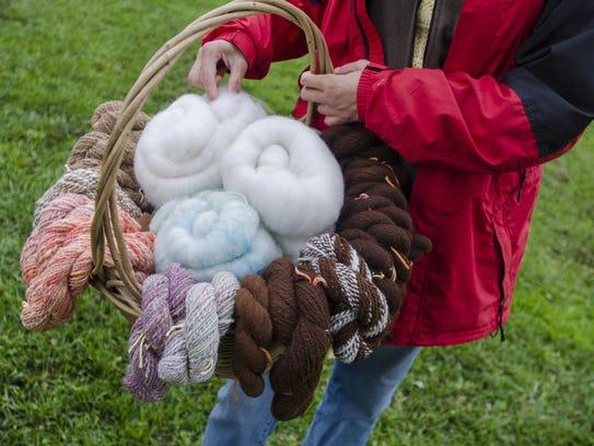Cronin holds a basket of alpaca yarn Sunday . Monica