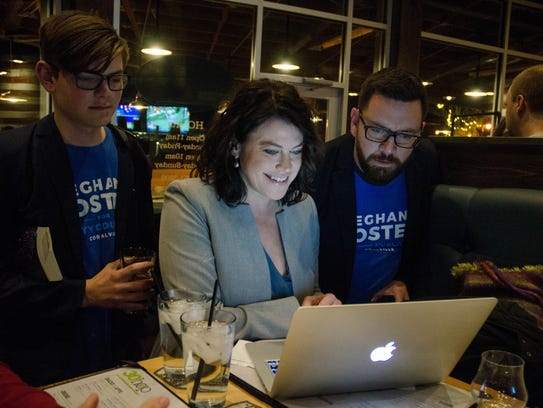 Meghann Foster watches early election results with