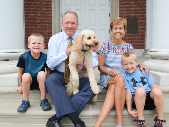 The Postel family. Left to right: Chris, Greg, Tesla (dog), Sally and Alex.