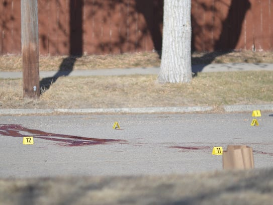 Blood on the pavement at the murder scene near 3rd