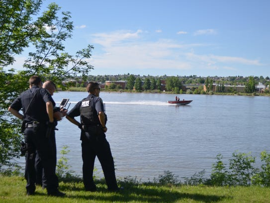 A search and rescue boat angles toward GFPD's drone
