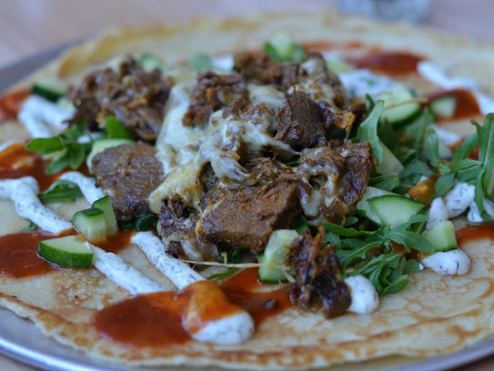 The Rotterdam ($10) is an excellent savory pancake (more similar to a crepe). The large Dutch pancake was filled with tender shwarma beef and drizzled with a creamy garlic dill sauce and curry ketchup, and served with cucumbers and arugula.