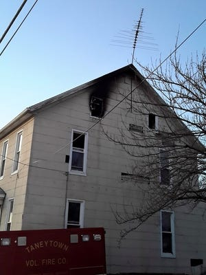A house is charred from a fire that killed a 2-year-old in Taneytown, Maryland, March 22.