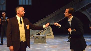 "Robert McLean as Henry Bolingbroke, left, and Robert Kauzlaric as King Richard II in the Michigan Shakespeare Festival's production of ""Richard II."""