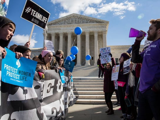 Demonstrators on both sides of the abortion debate