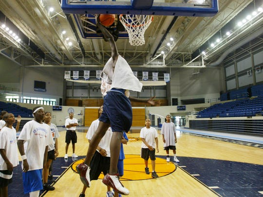Tennessee State University Basketball Camp participants wait for their turn with the ball as James Shaw, 16, attempts a dunk June 20, 2005 in TSU's Gentry Center.