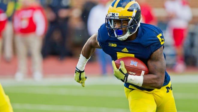Michigan running back Justice Hayes (5).