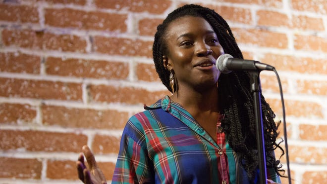 Rachel Egboro talked about finding the first love at the  Arizona Storytellers Project Valentine's event Feb. 11, 2015, the First Draft Book Bar in Phoenix.