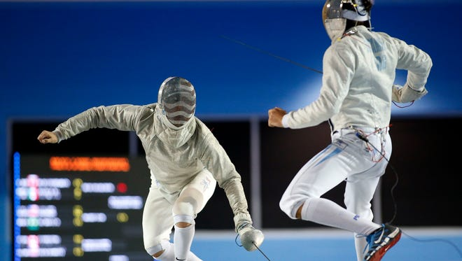 Eli Dershwitz of the United States fences Richardo Bustamante of Argentina in the men's semifinal sabre individual fencing