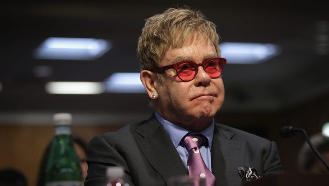 Elton John testifies during a hearing before the State, Foreign Operations and Related Programs Subcommittee of the Senate Appropriations Committee May 6, 2015 on Capitol Hill in Washington, DC. The subcommittee held the hearing on global health problems.