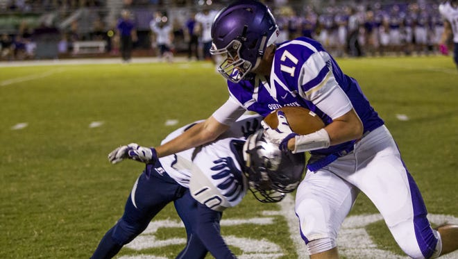 Queen Creek senior Zane Whiting catches the ball in a game against Ironwood Ridge on Oct. 9, 2015 in Queen Creek.