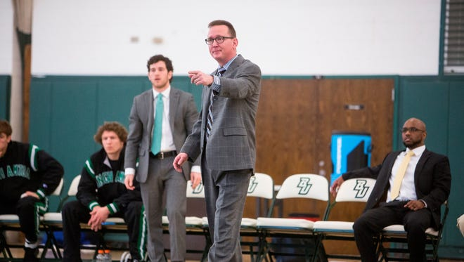 Binghamton University wrestling coach Matt Dernlan seen here during a meet against the University of Pennsylvania at the West Gym on January 25, 2015. Dernlan is starting his fourth season as the program's head coach.