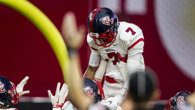 Centennial's Isaac Steele celebrates after rushing for a touchdown against Desert Ridge in the second quarter on Friday, Nov. 27, 2015 during the Division I state championship at University of Phoenix Stadium in Glendale, Ariz.