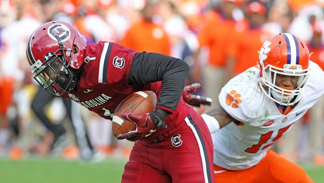 South Carolina Gamecocks wide receiver Deebo Samuel (1) sheds Clemson Tigers safety T.J. Green (15) after a catch in the fourth quarter at Williams-Brice Stadium, Saturday, November 28, 2015.