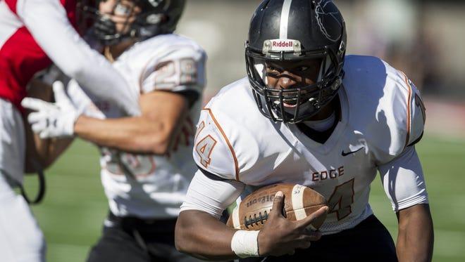 Desert Edge's Tehran Thomas rushes for a touchdown against Paradise Valley in the third quarter during the Division III state championship on Saturday, Nov. 28, 2015 at Arizona Stadium in Tucson, Ariz. Desert Edge won, 29-27.