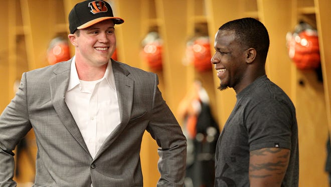 As they enter the 2016 offseason, the Bengals will balance having to find new players, like 2015 draft pick Tyler Kroft (left) and signing free agents like wide receiver Mohamed Sanu.