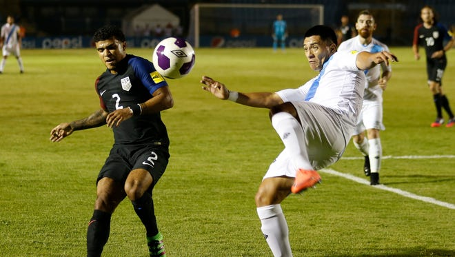 Guatemala's Rafael Morales, right,  clears the ball against United States' DeAndre Yedlin during a 2018 Russia World Cup qualifying soccer match.