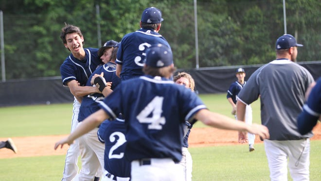 Maclay baseball players celebrate after a double play ended its game against NFC and the Marauders won 1-0 to go back to the state tournament for the first time since 1993. Senior pitcher Max McKinley went all eight innings for the complete-game shutout.