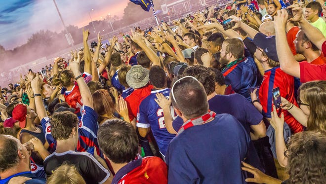 Indy Eleven fans celebrate Saturday night after the Eleven defeated Carolina 4-1 and in all likelihood captured the North American Soccer League Spring Season title.