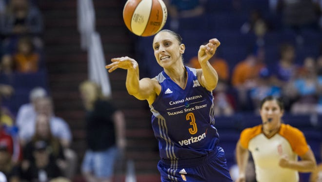 Mercury guard Diana Taurasi (3) passes under pressure against the Fever on Friday, July 8, 2016, at Talking Stick Resort Arena in Phoenix.