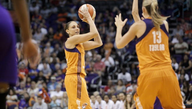Mercury guard Diana Taurasi (3) looks to pass to forward Penny Taylor (13) in the first half during a game against the Los Angeles Sparks at Talking Stick Resort Arena in Phoenix on Sunday, Aug. 28, 2016.