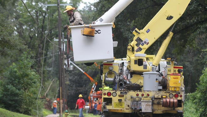 City of Tallahassee utility crew members fix damaged power lines in Indian Head Acres following Hurricane Hermine.