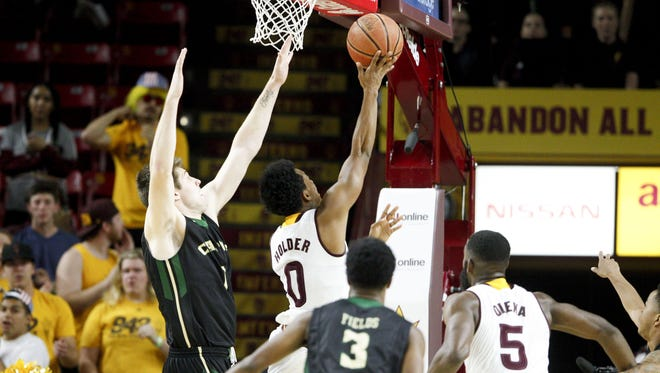 ASU junior guard Tra Holder (0) scores a layup during a game against Cal Poly in the first half at Wells Fargo Arena in Tempe on Sunday, Nov. 13, 2016.