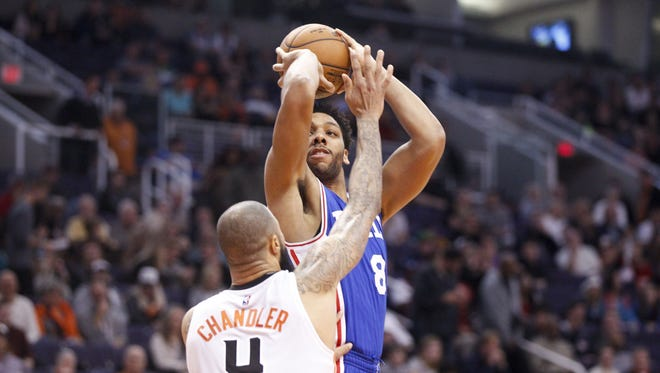 76ers center Jahlil Okafor (8) shoots a jumper over Suns center Tyson Chandler (4) in the second half at Talking Stick Resort Arena in Phoenix on Friday, Dec. 23, 2016.
