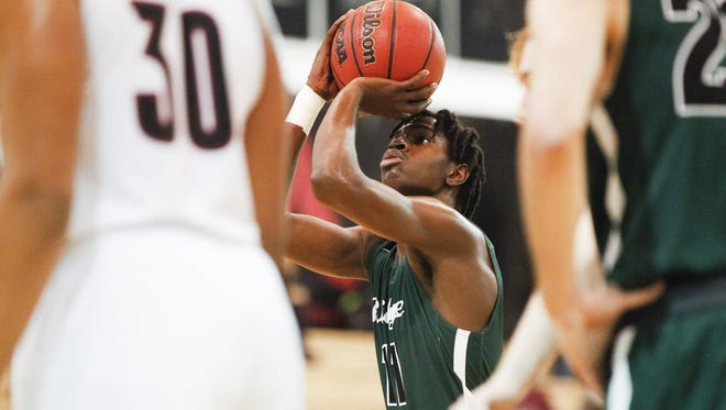 Mountain Ridge's Saikou Gueye (11) shoots a free throw in the first half against Red Mountain at Red Mountain High School in Mesa on Friday, Feb. 10, 2017.