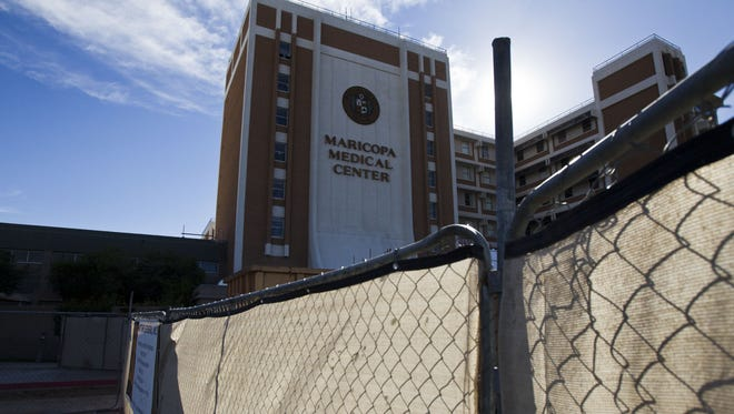 The board that oversees Maricopa Medical Center has awarded a contract to a construction firm to help manage the nearly $1 billion project of remaking the region's safety-net health system.