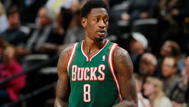 Milwaukee Bucks center Larry Sanders takes court against the Denver Nuggets in the fourth quarter of the Nuggets' 110-100 victory in an NBA basketball game in Denver on Wednesday, Feb. 5, 2014.