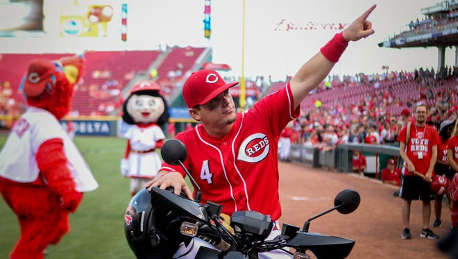 Cincinnati Reds second baseman Scooter Gennett (4) poses atop his new scooter before the game between the Cincinnati Reds and the Los Angeles Dodgers at Great American Ball Park on Friday, June 16, 2017.
