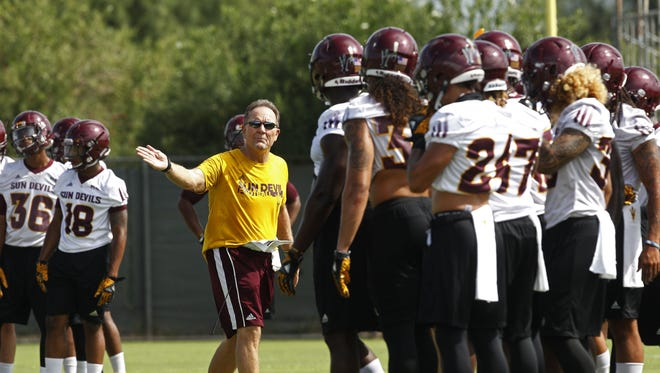 New defensive coordinator Phil Bennett directs drills during the team's first practice. Arizona State held their first football practice on Tuesday at Verde Dickey Dome.