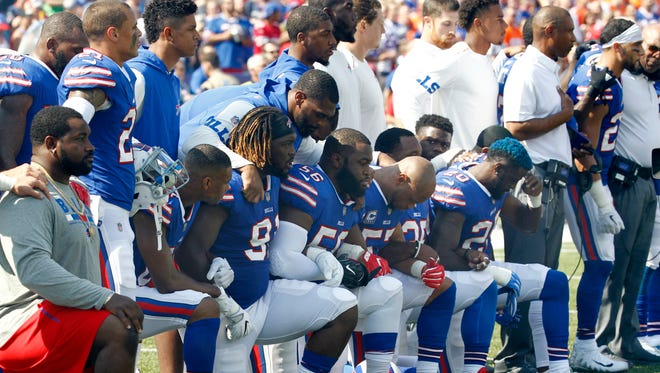 In this Sunday, Sept. 24, 2017, file photo, Buffalo Bills players take a knee during the playing of the national anthem prior to an NFL football game against the Denver Broncos in Orchard Park, N.Y. What began more than a year ago with a lone NFL quarterback protesting police brutality against minorities by kneeling silently during the national anthem before games has grown into a roar with hundreds of players sitting, kneeling, locking arms or remaining in locker rooms, their reasons for demonstrating as varied as their methods.